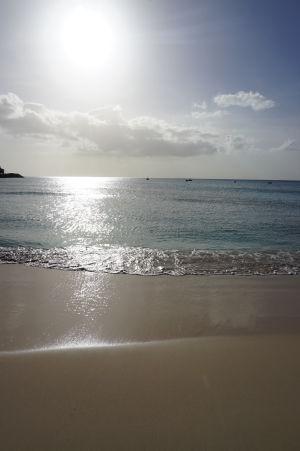 Blížiaci sa západ Slnka na pláži Brighton Beach